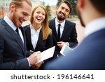 happy businesswoman looking at... | Shutterstock . vector #196146641