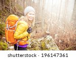 Woman Hiking In Autumn Forest...