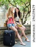 two happy women with luggage... | Shutterstock . vector #196159679