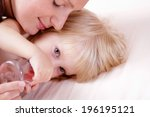 young happy mother with baby... | Shutterstock . vector #196195121