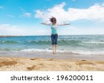beautiful girl jumping on a... | Shutterstock . vector #196200011