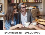 fashion couple receiving cup of ... | Shutterstock . vector #196204997