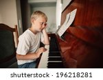 Little Boy Plays Piano At Home