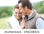 cheerful 40 year old couple... | Shutterstock . vector #196238321