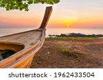Wooden Boat On Sunset Beach....