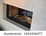 A Fireplace With A Glass Window ...