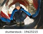 Kid on a slide - stock photo