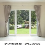 opened door   green garden view | Shutterstock . vector #196260401