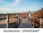 Young Woman Walking On Wooden...