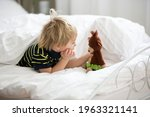 Blond Toddler Child In Bed With ...