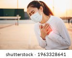Small photo of Portrait of Asian woman having suffering from chest pain or heart attack. Heart disease or chest pain can indicate a serious problem, it's important to seek immediate medical help.