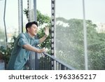 Handsome Man Leaning On Rail ...