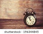 Retro Alarm Clock On A Table....