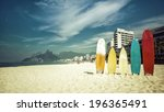 surfboards standing upright in... | Shutterstock . vector #196365491