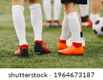 Legs Of Soccer Players In Red...
