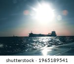 Ships On Sea During Sunset