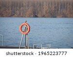 Orange Lifebuoy Hanging On A...
