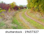 colors of autumn along a rural road - stock photo