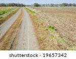 rural road at autumn - stock photo