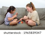 Two Cute Children Playing With...