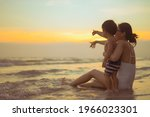 Happy Family Resting At Beach...