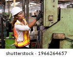 Factory Woman Worker At Work In ...
