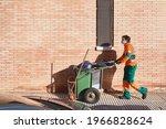 Male Street Sweeper Wearing A...