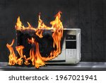Microwave Oven White  In Fire...