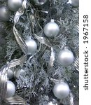 Christmas tree with silver decoration - stock photo