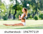 young woman in white sitting on ... | Shutterstock . vector #196797119