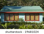 A brightly coloured home on the tropical island of Rarotonga in the Cook Islands - stock photo