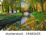 Autumn View Of A Bridge Over A...