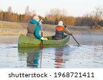 Mother And Daughter Rowing A...