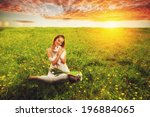 woman sitting on field before... | Shutterstock . vector #196884065