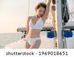 Woman Wearing White Swimsuit...