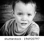 A Close Up Of A Young Boy With...