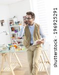 young designer at phone using a ... | Shutterstock . vector #196925291