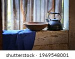 Black Kettle And Wooden Bowl...