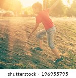 boy climbing slope against... | Shutterstock . vector #196955795