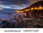 the shoreline of a mountain lit ... | Shutterstock . vector #196957109