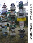 Small photo of Watson Lake, Yukon, Canada - August 7 2016: The sign Post Forest is the biggest attraction in Watson Lake on the Alaska Highway in Yukon