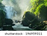a waterfall cascades over the... | Shutterstock . vector #196959311