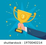 hand with trophy cup.... | Shutterstock .eps vector #1970040214
