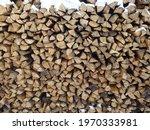 Neatly Stacked Woodpile Of...