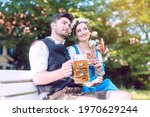 Woman and man in bavarian...