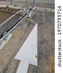 White Arrow On Concrete With...