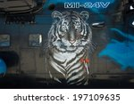 Small photo of BERLIN, GERMANY - MAY 22, 2014: Image of the tiger (aerography) on board of the attack helicopter Mil Mi-24V Hind. Czech Air Force. Exhibition ILA Berlin Air Show 2014