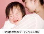 baby crying while being hugged... | Shutterstock . vector #197113289