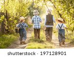 four boys with fishing rods go... | Shutterstock . vector #197128901