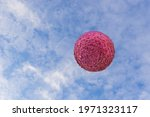 A Large Ball Made Of Pink...